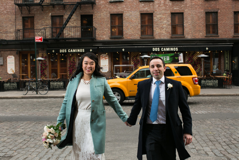 NYC Bride and groom in front of taxi