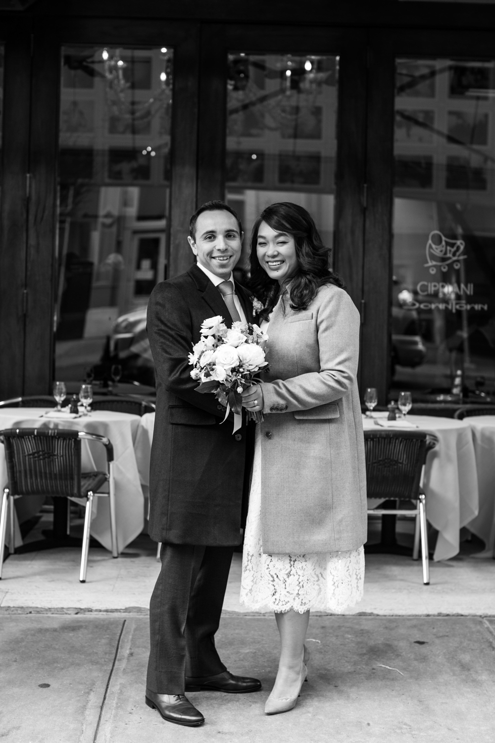 Black and white photograph of newlyweds celebrating in NYC