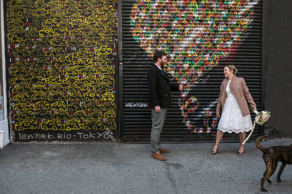 Bride and groom stop by Manhattan art