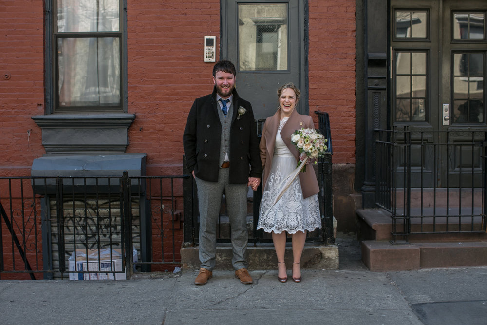 Photograph of bride and groom holding hands in Manhattan