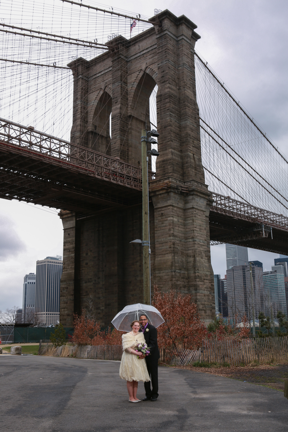 Bride and groom under bridge in NYC