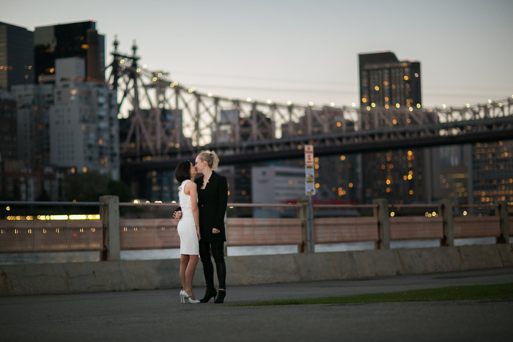 Kissing in front of NYC bridge