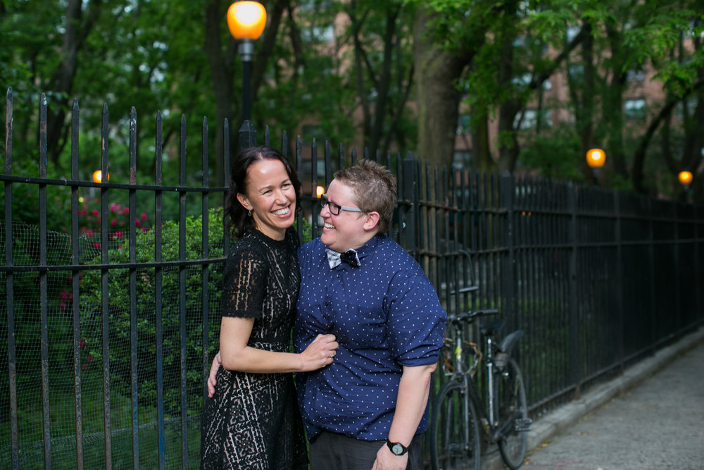 photography of NYC couple laughing together