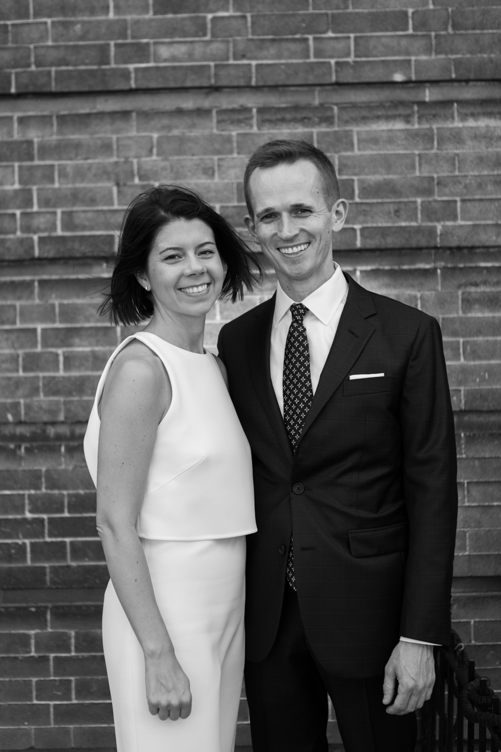 Black and white portrait of a couple on their wedding day.
