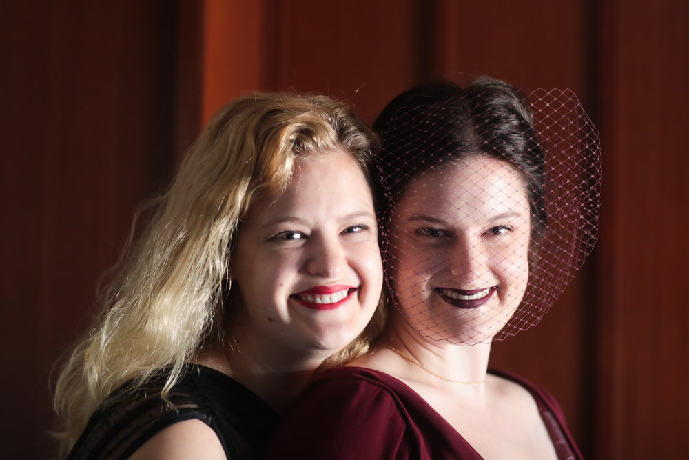 Portrait of a bride and her friend on her wedding day.