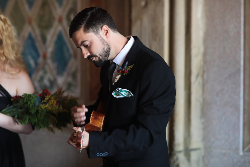 A friend of the groom plays a song.