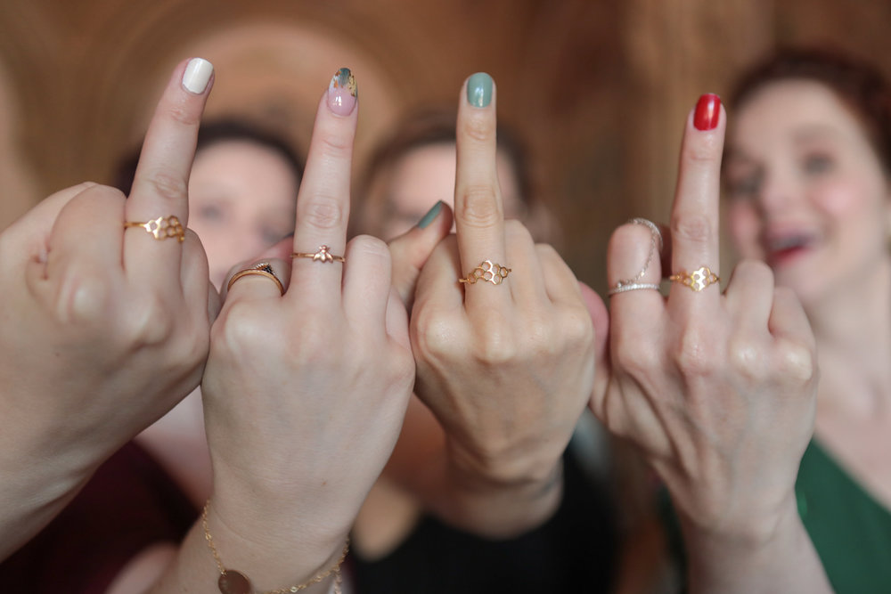 The bride's beyhive shows off their honeycomb rings.