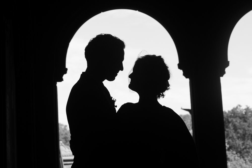 Silhouette of a bride and groom after eloping.