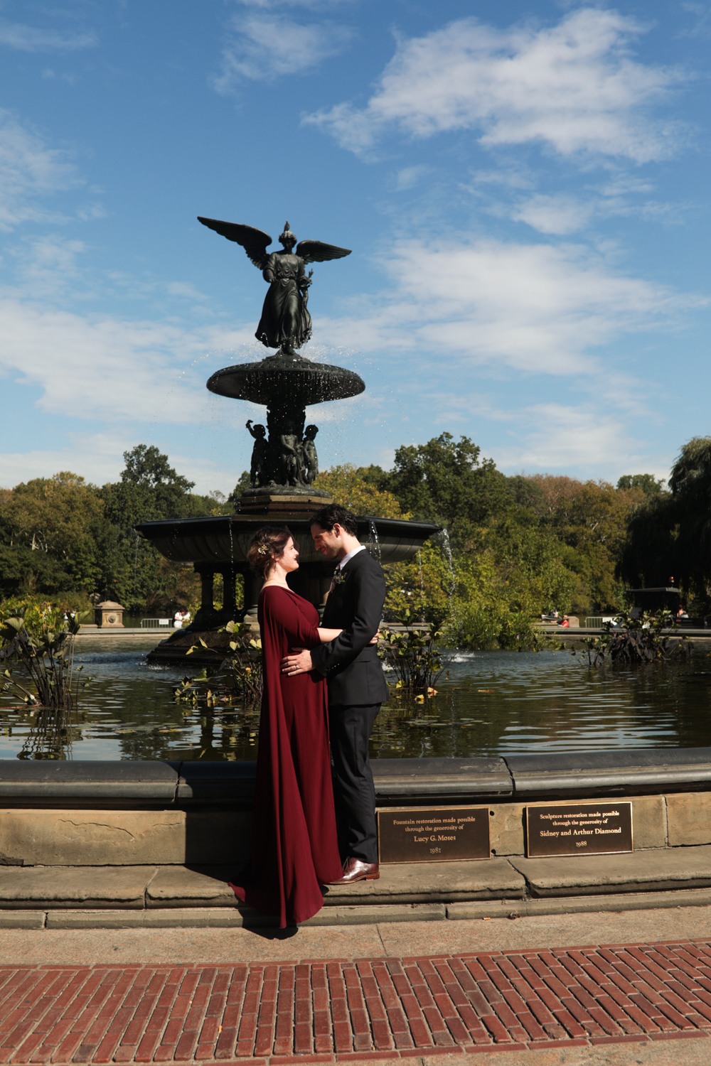 Portrait of a bride and groom at Bethesda Fountain in Central Park.