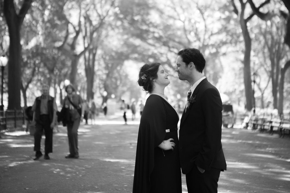 Black and white photo of a bride and groom on their wedding day in Central Park in New York City.