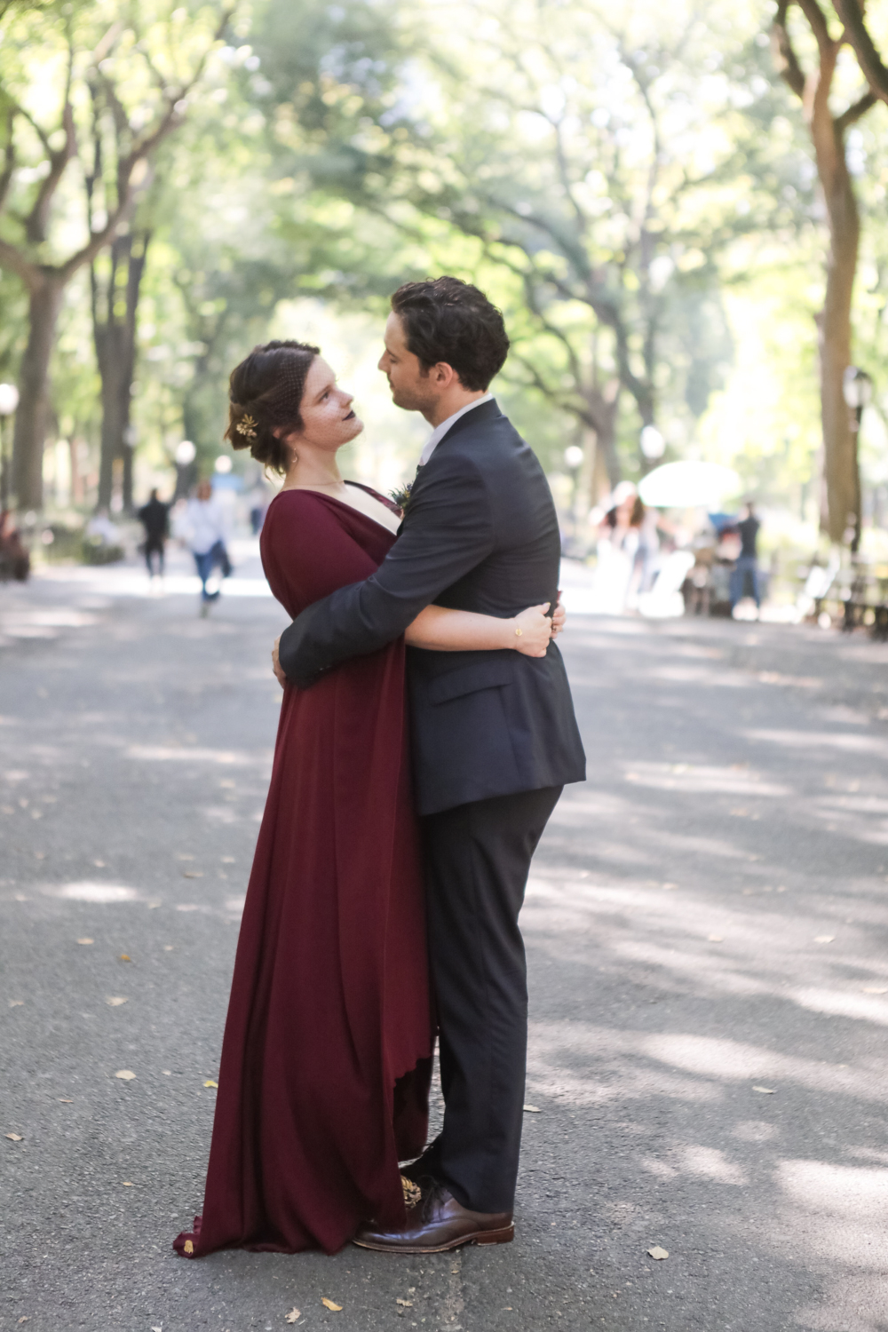 A bride and groom embrace after eloping in Central Park.