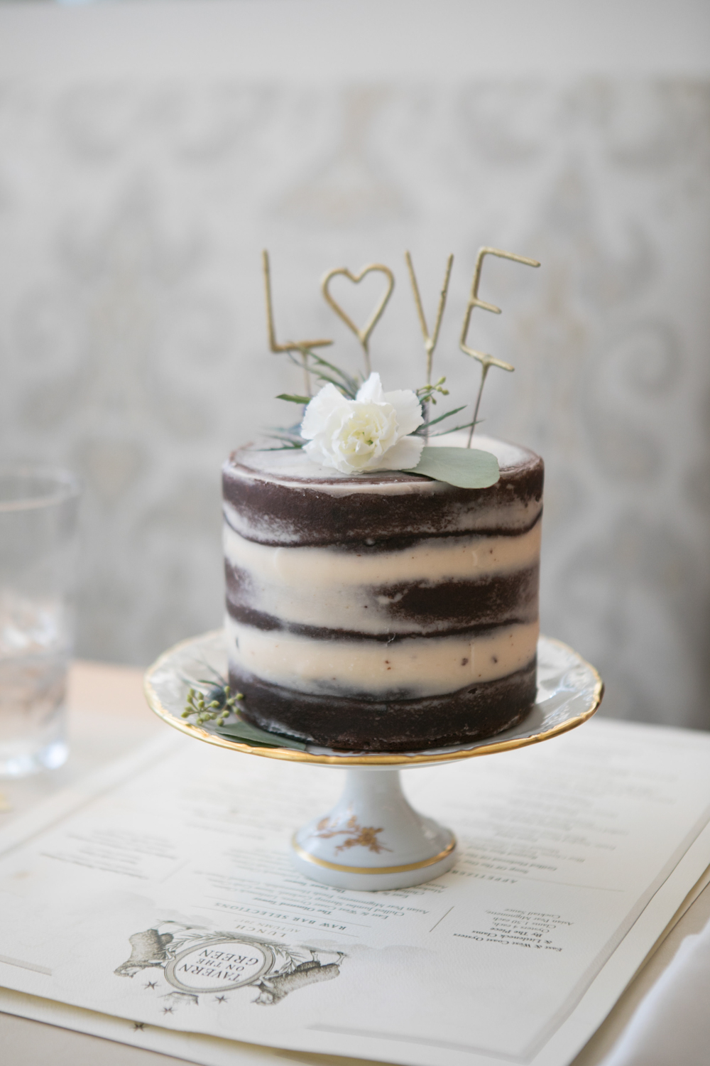 Wedding cake with LOVE topper at Tavern on the Green in Central Park.