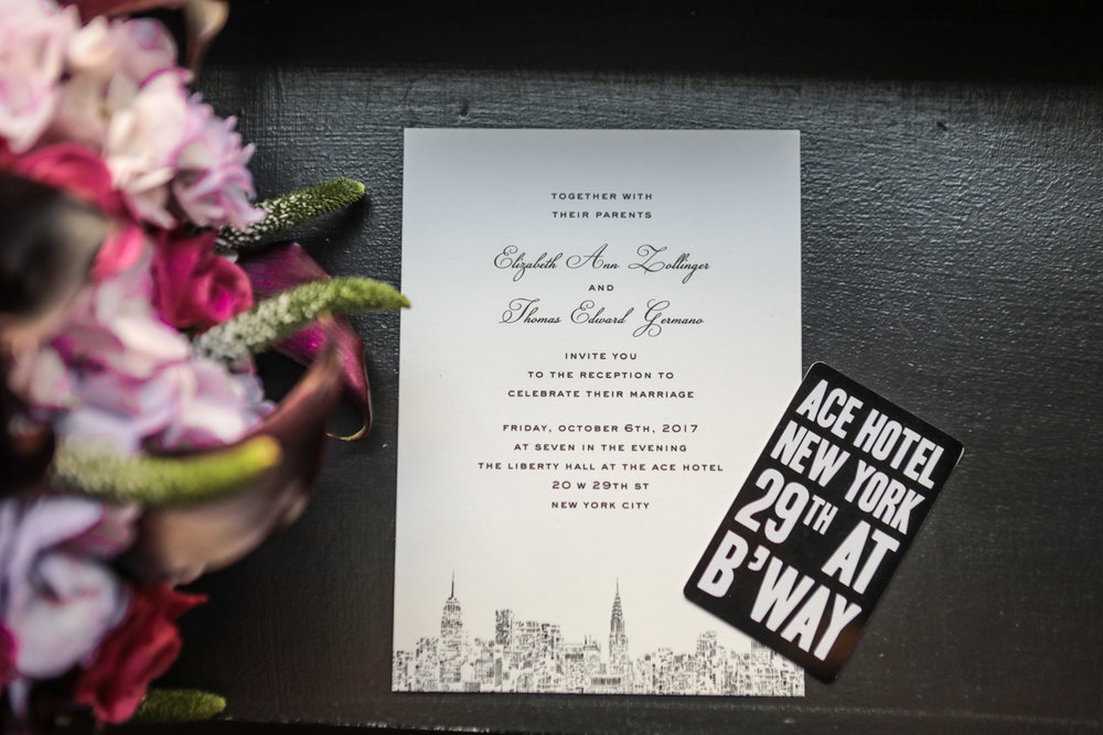 Invitation with the New York City Skylinefor a wedding reception at the ACE Hotel