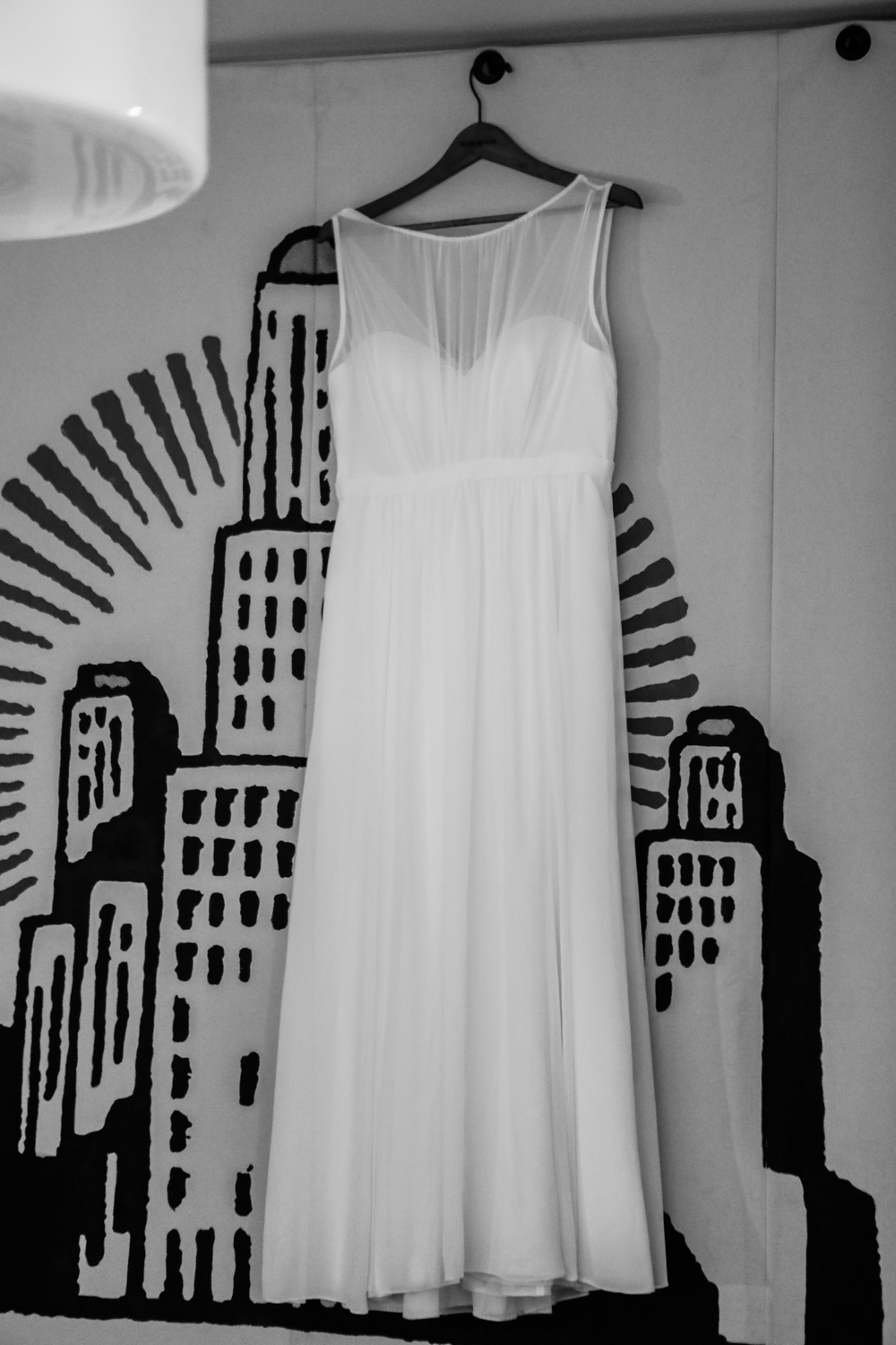 Long white wedding dress from the Jenny Yoo collection at Modcloth hangs in the ACE Hotel.