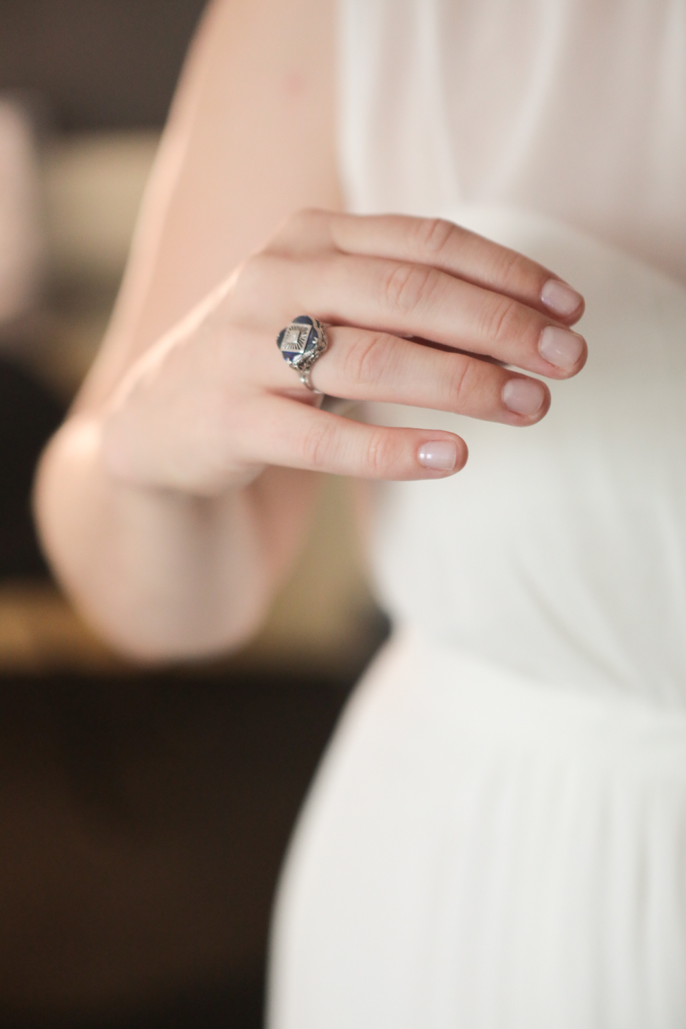 Bride shows off her grandmother's wedding ring that she is wearing on her right hand.