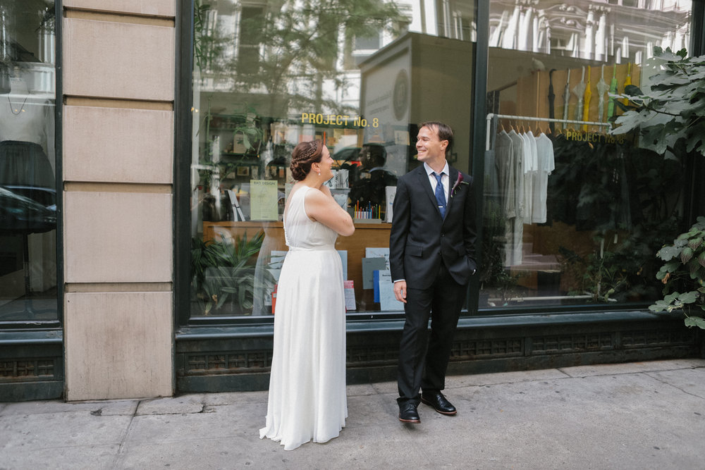 Bride and groom have their first look on the sidewalk of New York.