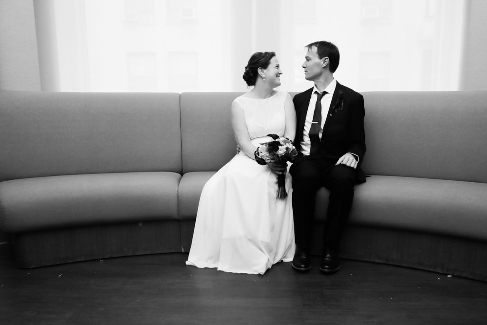 Black and white portrait of a bride and groom waiting to get married at City Hall in New York City.