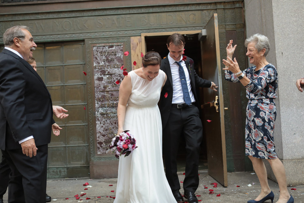 Showering the bride and groom with rose petals after getting married at City Hall in New York City.