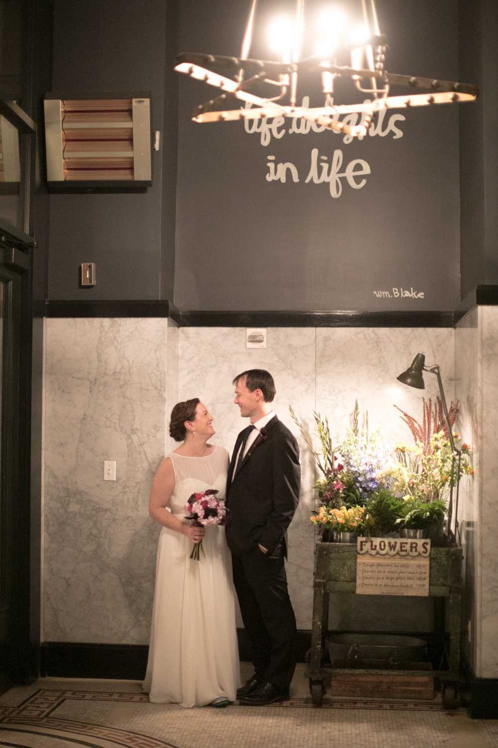 Portrait of a bride and groom at their ACE Hotel wedding reception.