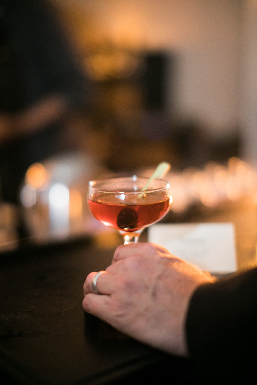 A guest takes a cocktail at an Ace Hotel wedding reception.
