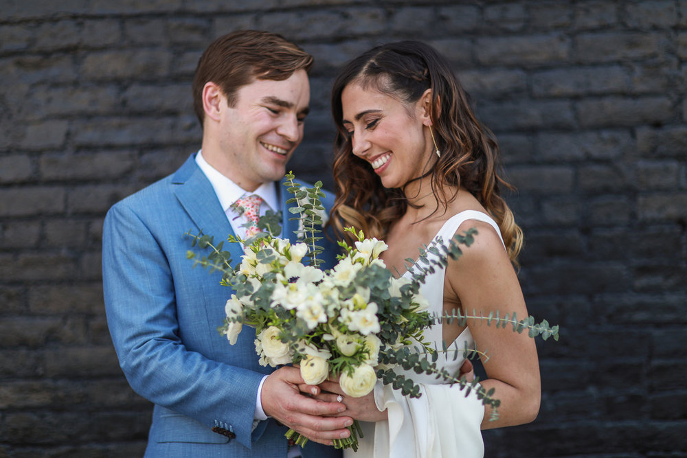 Portrait of a bride and groom in front of a brick wall - 501 Union Wedding Photos in Brooklyn - Luna & Tom's Wedding