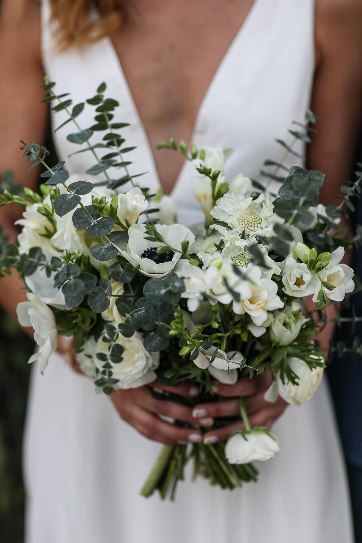 Bride holds her wedding bouquet of white flowers -501 Union Wedding Photos in Brooklyn - Luna & Tom's Wedding