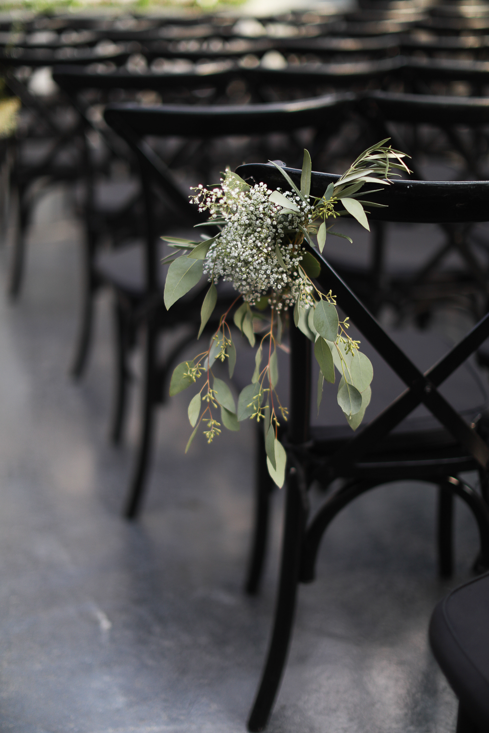 Natural embellishments on wedding chairs at a Brooklyn wedding - 501 Union Wedding Photos in Brooklyn - Luna & Tom's Wedding