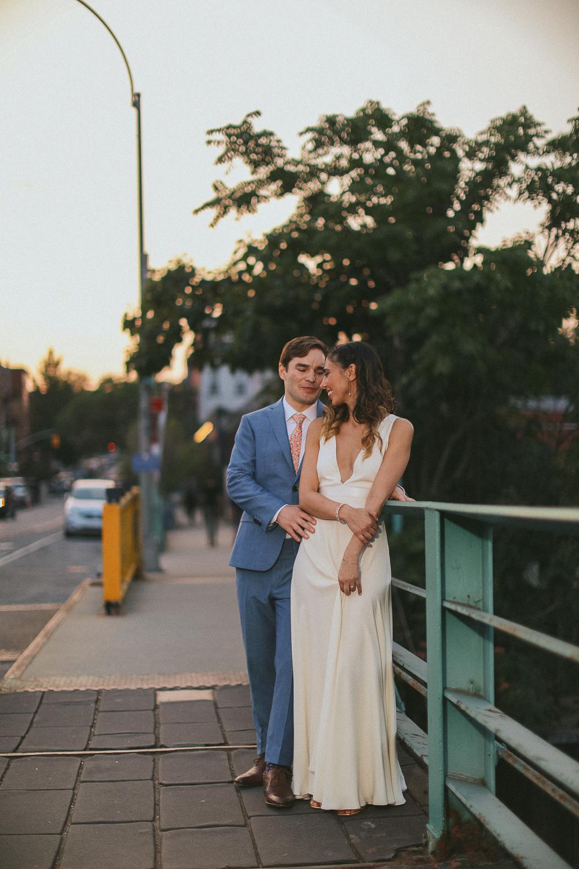 Portrait of a bride and groom embracing on a New York sidewalk -501 Union Wedding Photos in Brooklyn - Luna & Tom's Wedding