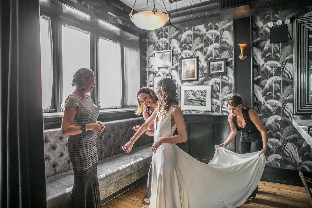 Bridesmaids help the bride get ready on her wedding day -501 Union Wedding Photos in Brooklyn - Luna & Tom's Wedding