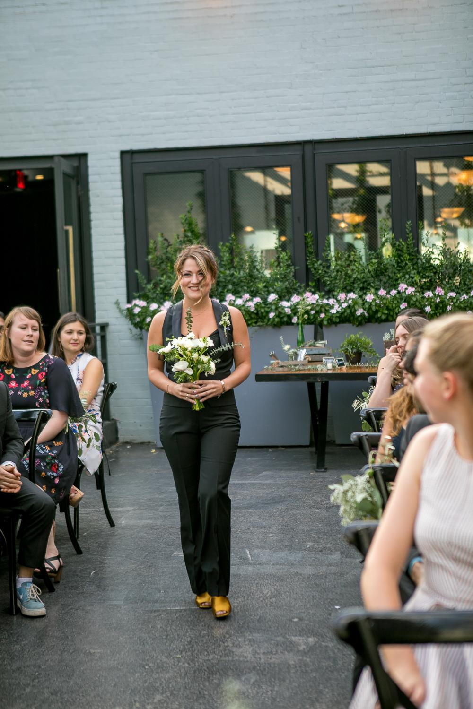 Bridesmaid wearing a black vest suit at a Brooklyn wedding -501 Union Wedding Photos in Brooklyn - Luna & Tom's Wedding