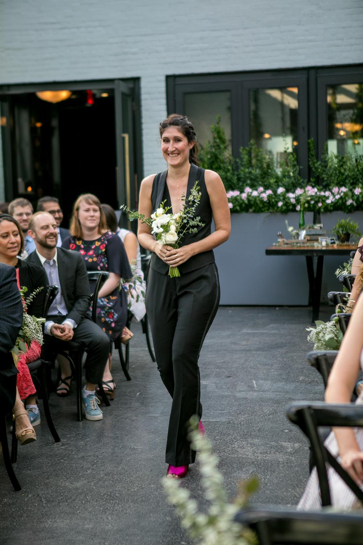 Bridesmaid in a black suit in a Brooklyn wedding - 501 Union Wedding Photos in Brooklyn - Luna & Tom's Wedding