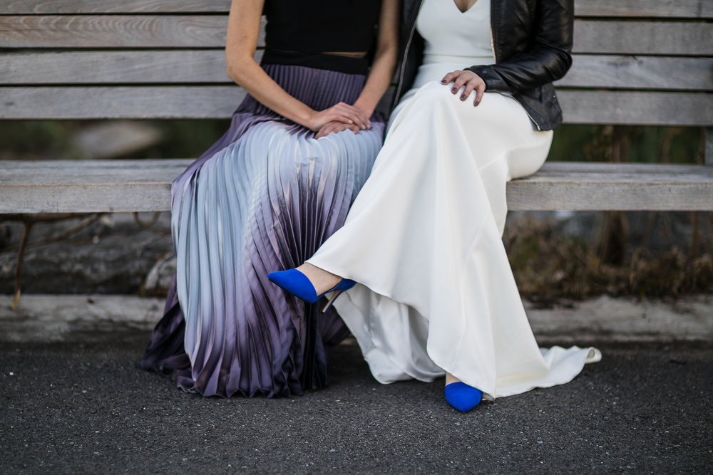 Two brides sit next to each other on a bench | 26 Bridge Wedding Photos | Lesbian Brooklyn Wedding | Kristin and Marisa's Wedding