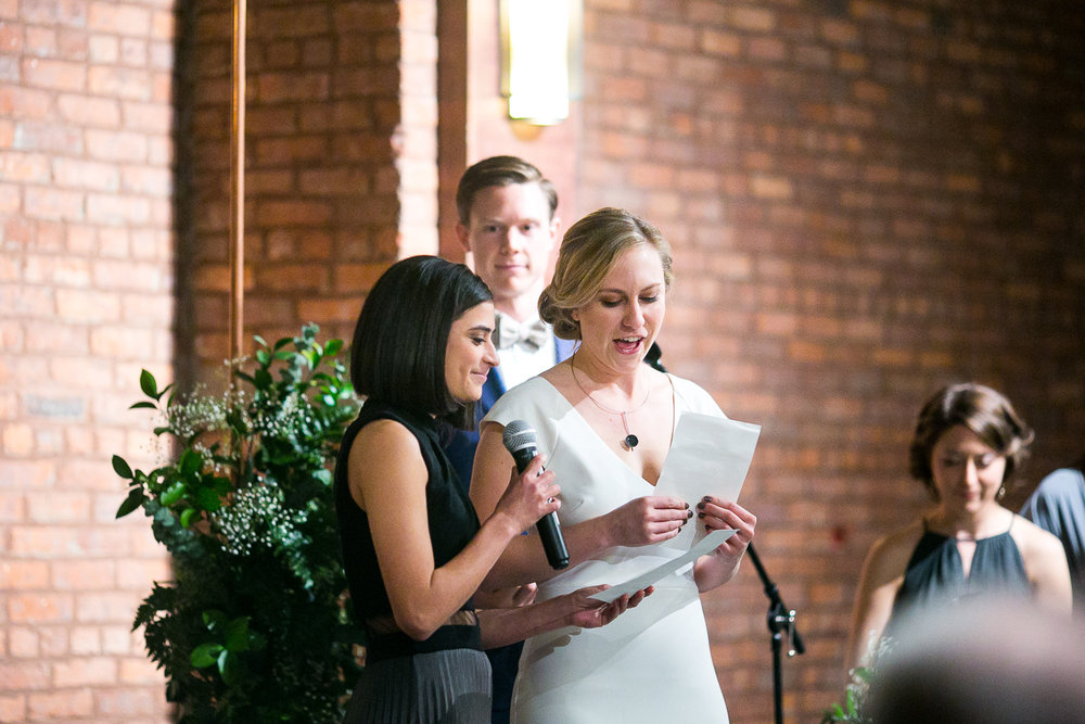Brides read their vows | 26 Bridge Wedding Photos | Lesbian Brooklyn Wedding | Kristin and Marisa's Wedding