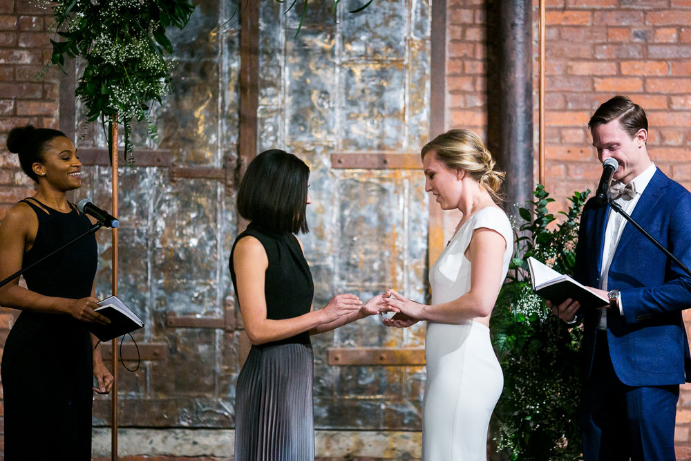 Brides exchanging rings | 26 Bridge Wedding Photos | Lesbian Brooklyn Wedding | Kristin and Marisa's Wedding