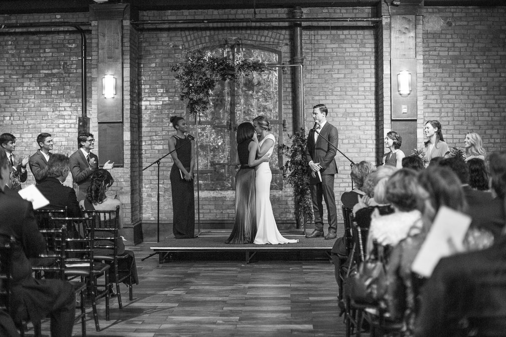 Black and white photo of a wedding ceremony at 26 Bridge in Brooklyn, New York | 26 Bridge Wedding Photos | Lesbian Brooklyn Wedding | Kristin and Marisa's Wedding