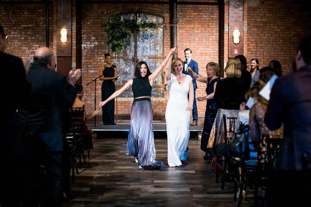 Brides walk down the aisle at a wedding ceremony in Brooklyn, New York | 26 Bridge Wedding Photos | Lesbian Brooklyn Wedding | Kristin and Marisa's Wedding