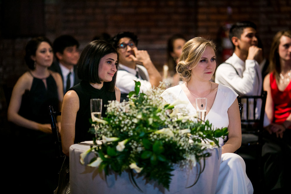 Listening to toasts at a 26 Bridge wedding reception | 26 Bridge Wedding Photos | Lesbian Brooklyn Wedding | Kristin and Marisa's Wedding