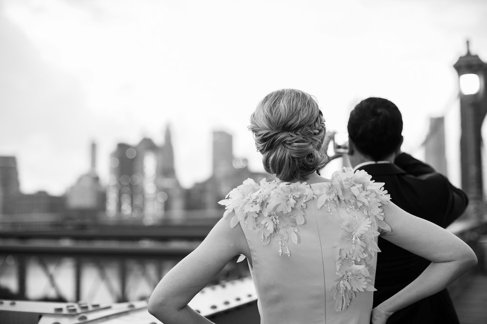 A couple poses on the Brooklyn Bridge at Sunrise | Brooklyn Bridge Anniversary Session | Brooklyn Bridge Wedding Photos | New York City Wedding Photographer