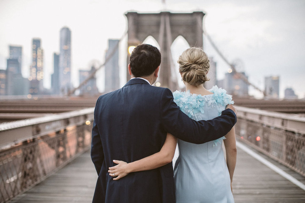 A couple poses on the Brooklyn Bridge at Sunrise | Brooklyn Bridge Anniversary Session | Brooklyn Bridge Wedding Photos | Early Morning Brooklyn Bridge Engagement Photos