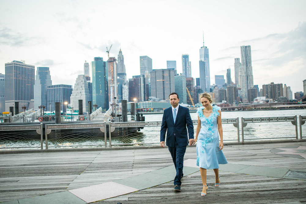 A couple poses near the Brooklyn Bridge at Sunrise | Brooklyn Bridge Anniversary Session | Brooklyn Bridge Wedding Photos | Brooklyn Bridge Engagement Photos