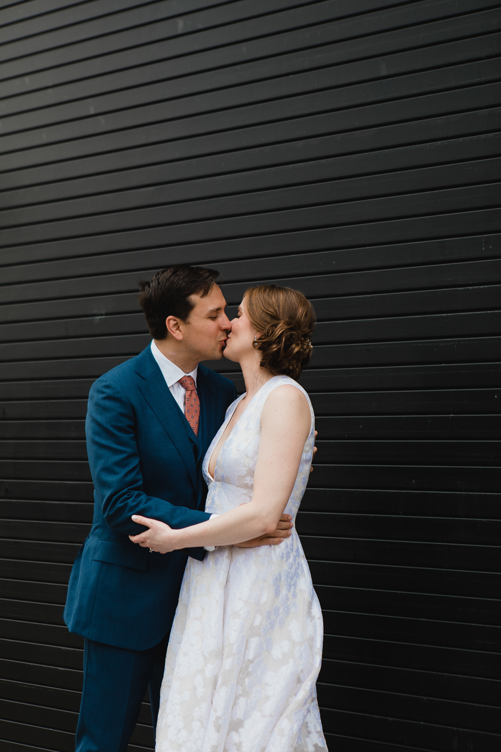 bride and groom kissing at their brooklyn wedding