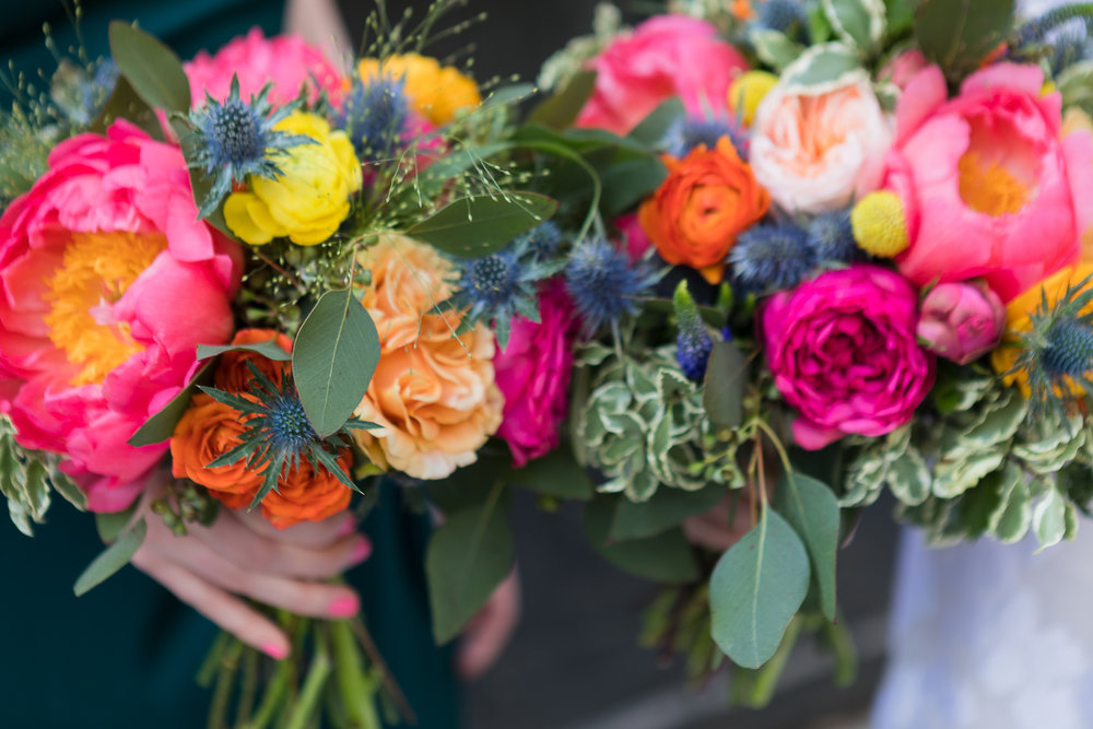 peony bouquets with pink, orange, and yellow