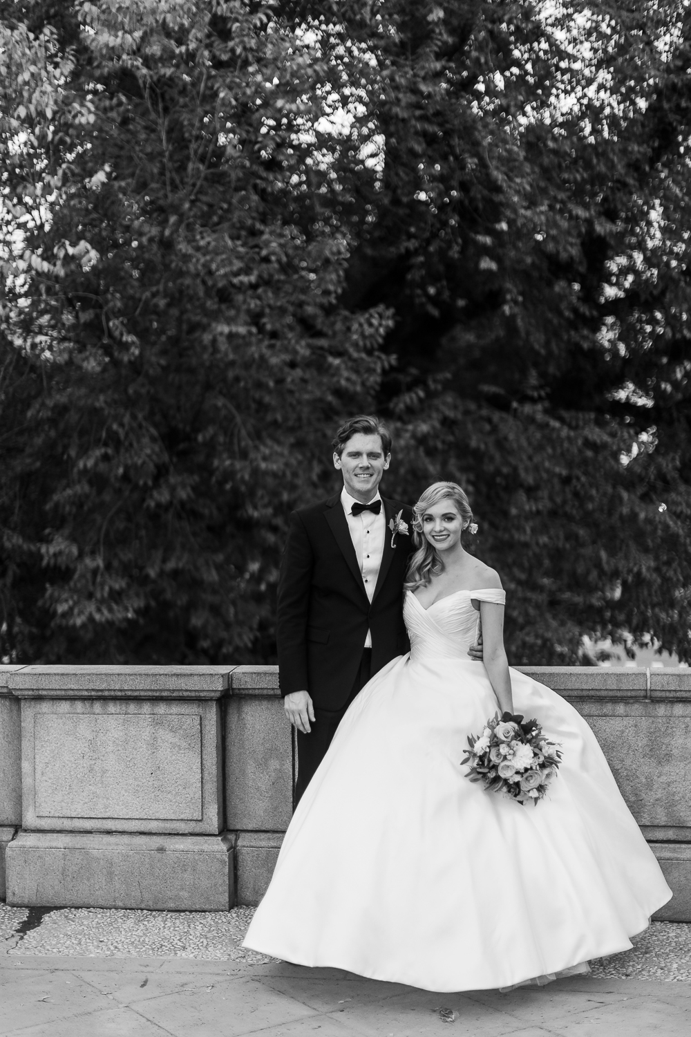 Classic black and white wedding photo of a bride and groom.