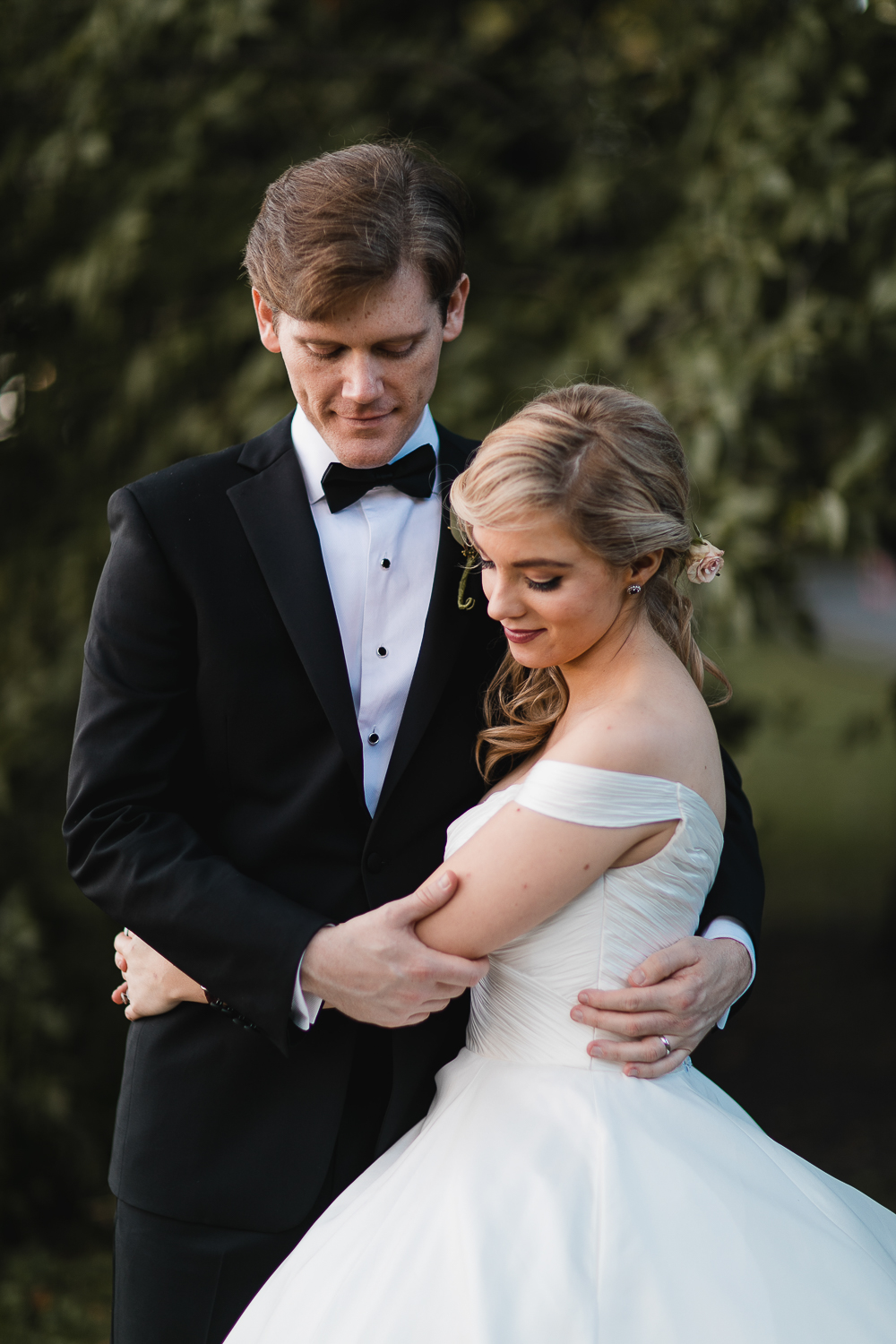 Bride and groom softly embracing each other.