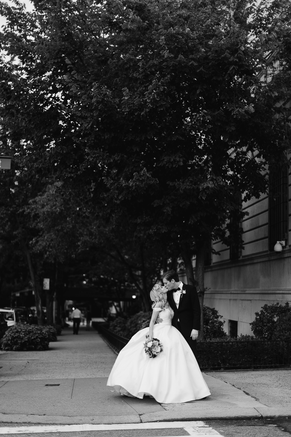 Black and white photos of a bride and groom kissing on Manhattan streets.