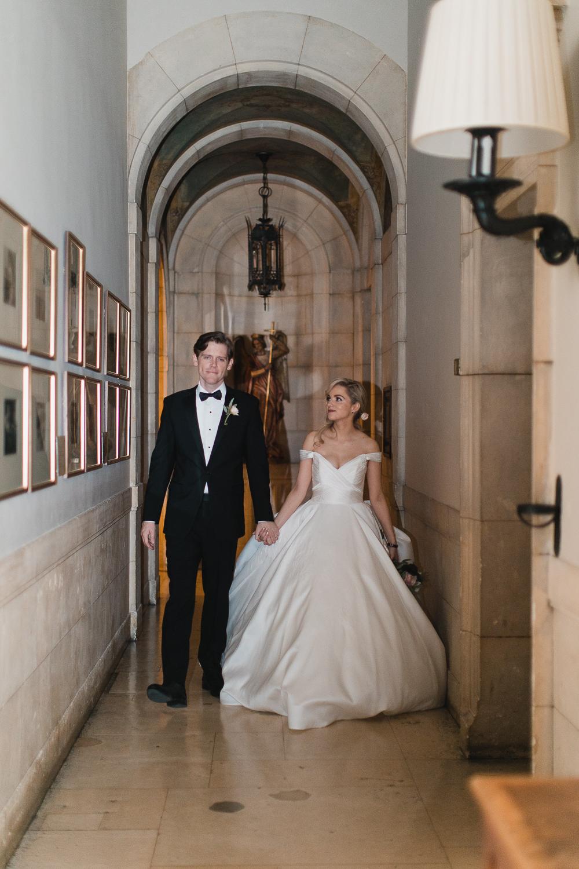 Bride and groom walk together at a Burden Kahn Mansion Wedding.