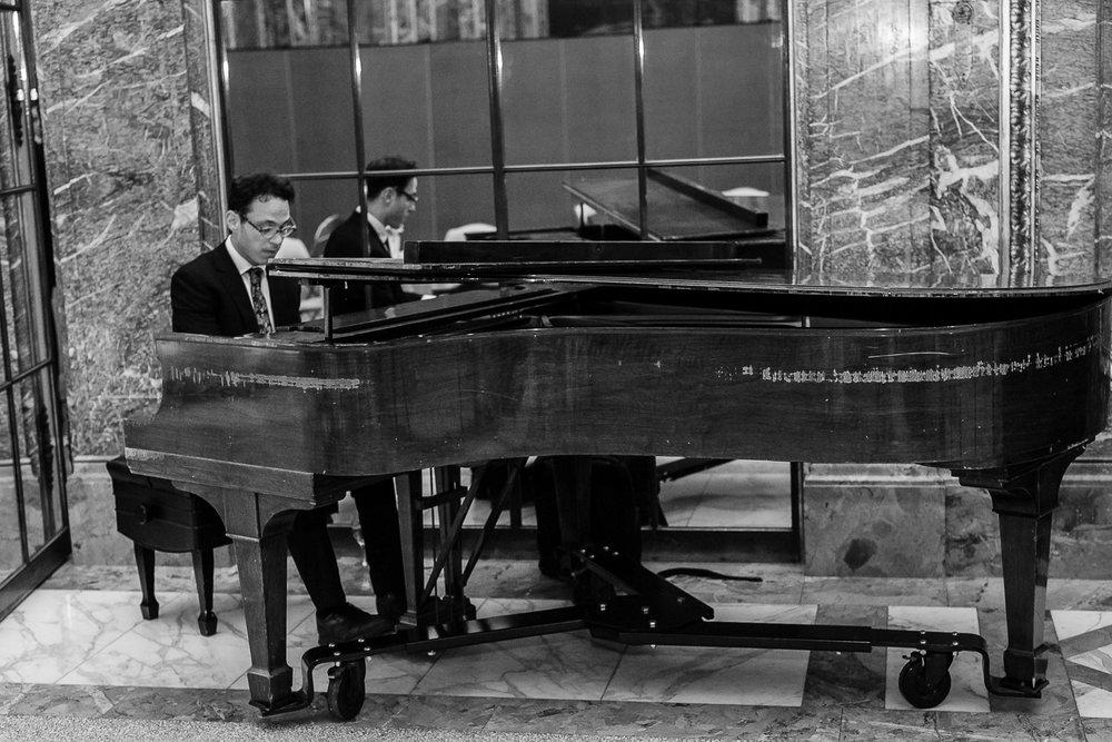 Man playing a piano at a wedding.