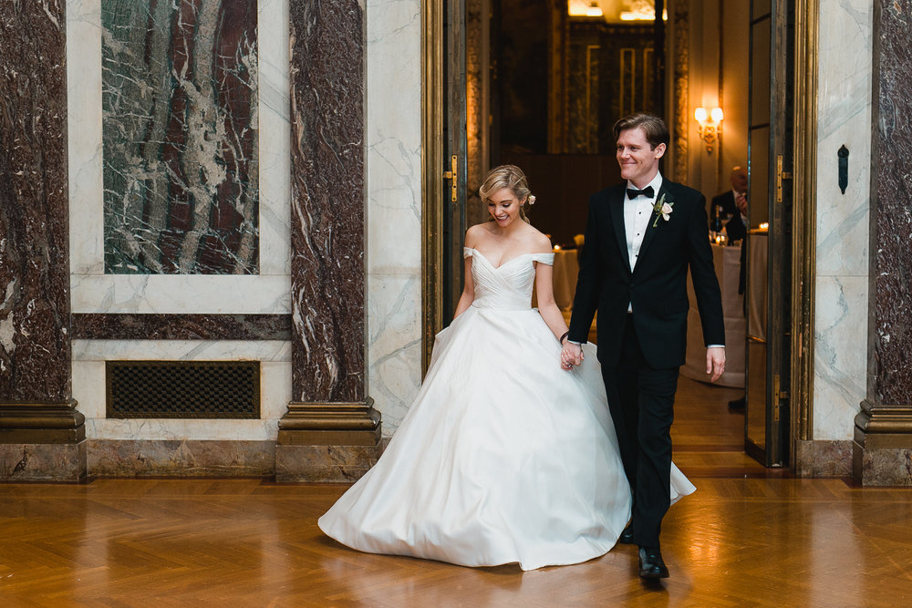 Bride and groom entering their wedding reception.