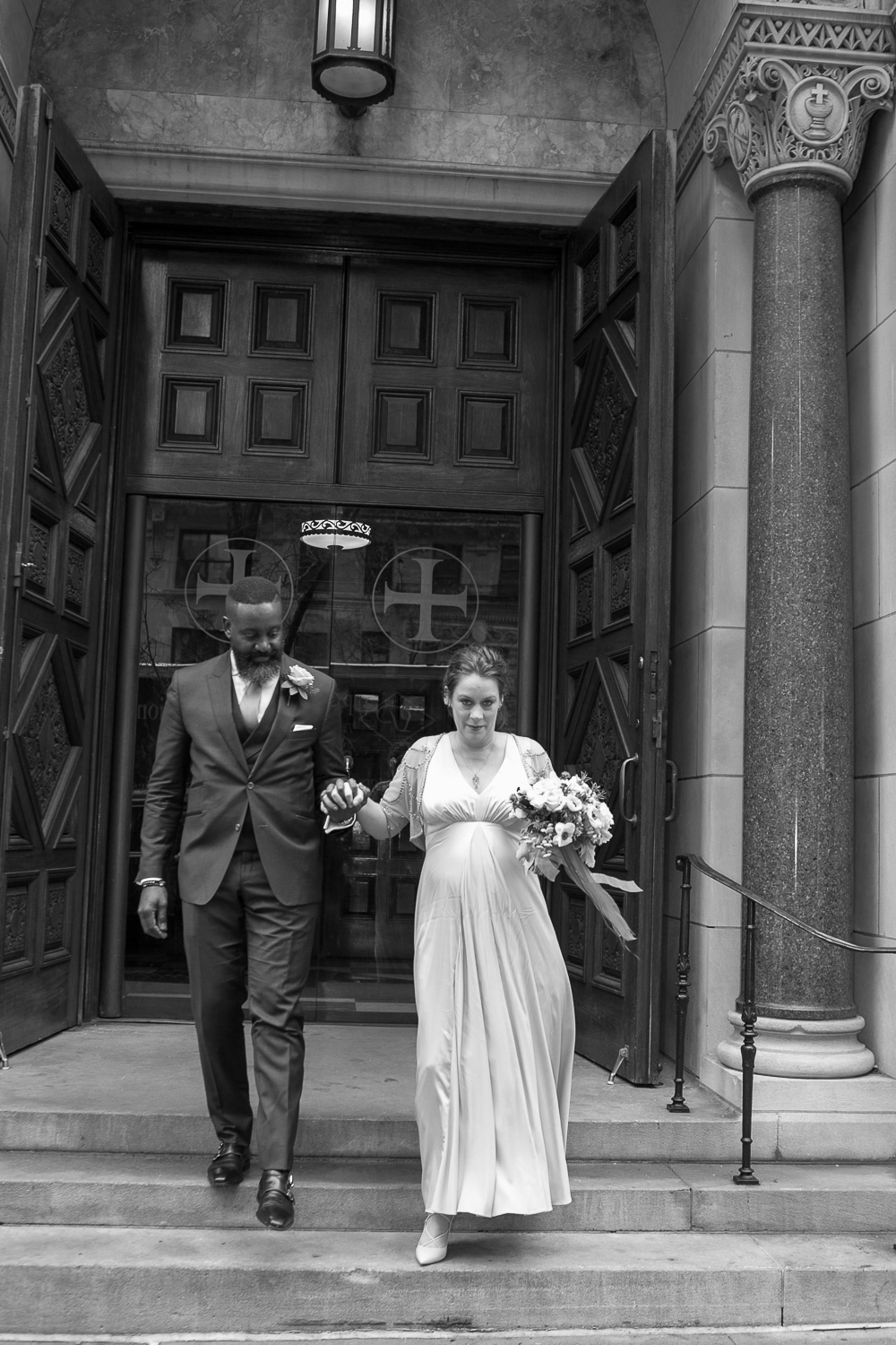 The bride and groom pose outside the Upper West Side Wedding Venue. | Upper West Side Intimate Wedding | Kate & Sylvester's wedding in Manhattan.