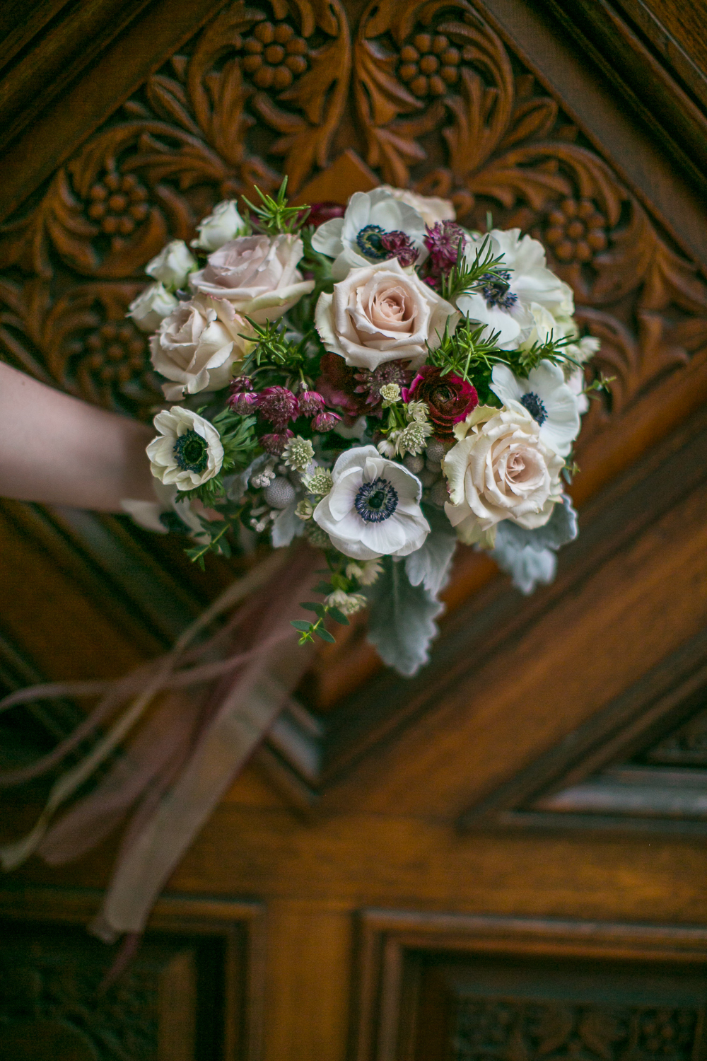 The bride's bouquet of white, purple, and blush flowers. | Upper West Side Intimate Wedding | Kate & Sylvester's wedding in Manhattan.